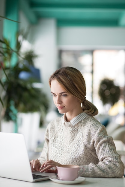 Concentrated lunch businesswoman white typing Free Photo