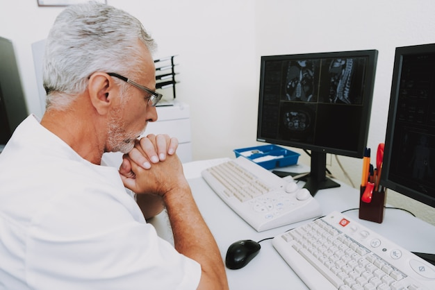 Concentrated radiology doctor examining ct scans Premium Photo