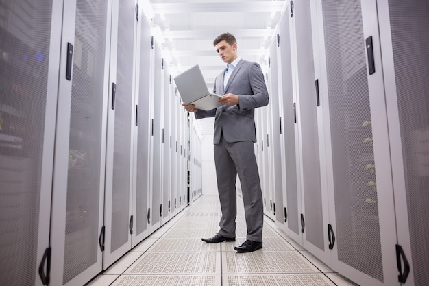 Concentrated technician in suit standing Premium Photo