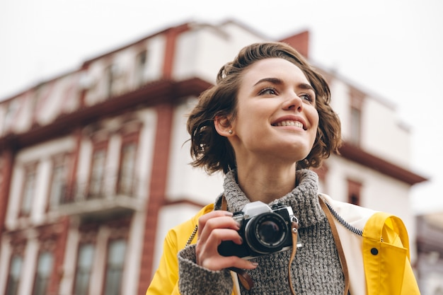 Concentrated young lady photographer Free Photo