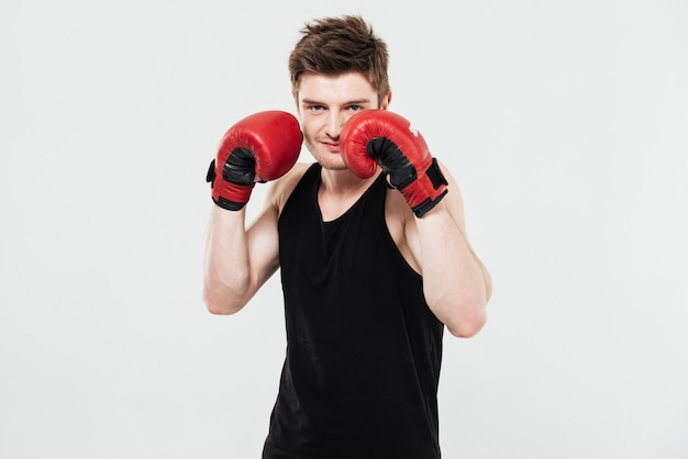 Concentrated young sportsman boxer Free Photo
