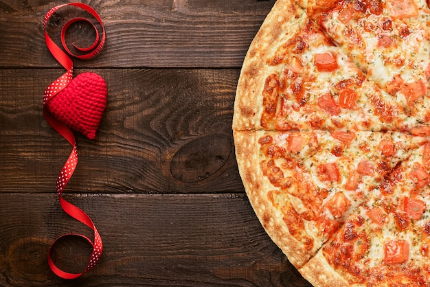 The concept of an advertising banner for valentine's day pizza as a gift with space for text Premium Photo