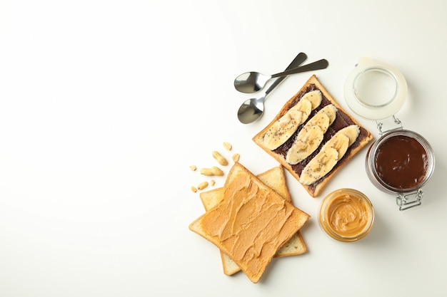 Concept of breakfast with toasts with peanut butter and chocolate Premium Photo