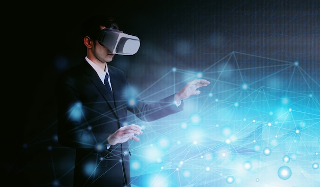 Concept of a businessman in vr working Premium Photo