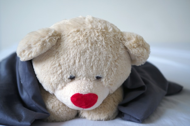 The concept of child sorrow teddy bear lying alone, sad and disappointed Premium Photo