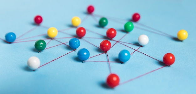 Concept of communication with pins blue background Premium Photo