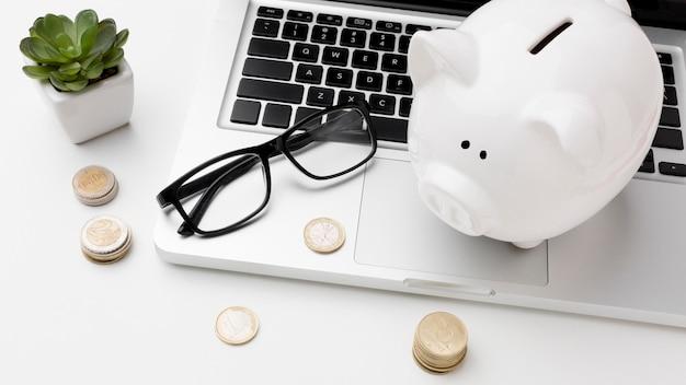Concept of economy with piggy bank on laptop Premium Photo