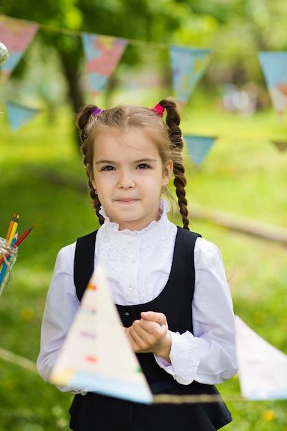Concept - education. back to school. portrait of a beautiful caucasian schoolgirl girl Premium Photo