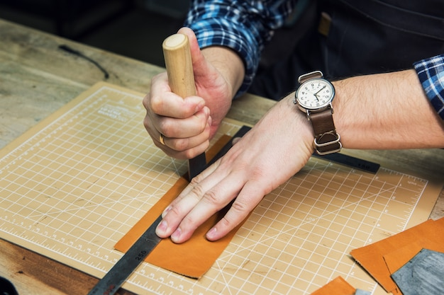 Concept of handmade craft production of leather goods. Premium Photo