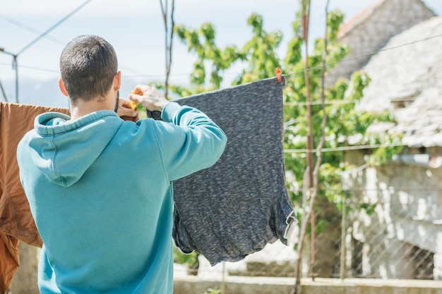 Concept of hanging clothes to dry in garden Free Photo