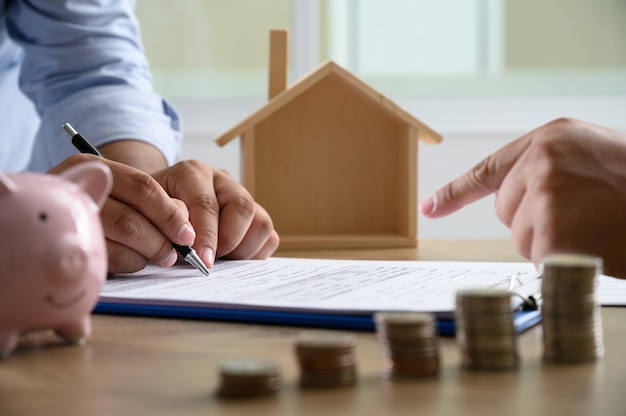 The concept of home ownership business people negotiating a contract this is where you need to sign Premium Photo