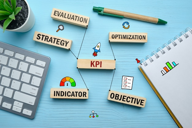 The concept of kpi and the main connections with it on wooden blocks. Premium Photo