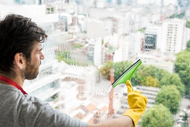 Concept of man cleaning his home Free Photo