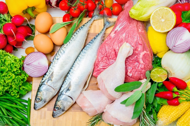 Concept of mediterranena diet with fish,meat and vegetables Premium Photo