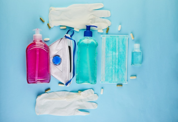 The concept of the outbreak of coronavirus covid-19, how to protect yourself from infection. wash hands, wear face shield, pills, hand sanitizer, gel, protective gloves. copy space Premium Photo