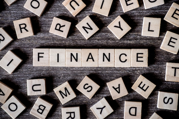 Concept Presented By Crossword With Words Finance With Many Wooden