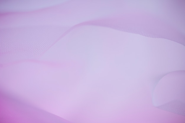 Concept of purple material in fine mesh in pinkness Free Photo