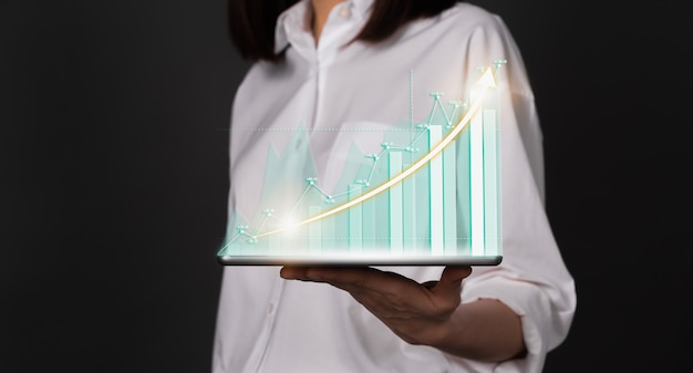 Concept stock market exchanges. woman hand holding digital tablet and showing financial graph. Premi