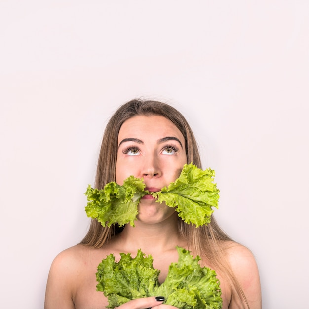 Concept of young woman eating fresh salad Free Photo