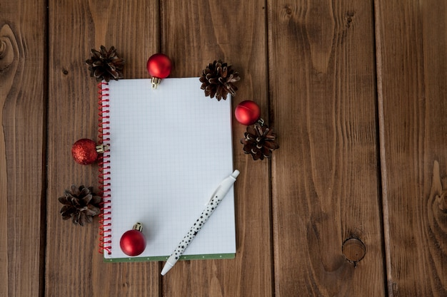 Conceptual composition on a wooden table with notebook with plans for the year Premium Photo