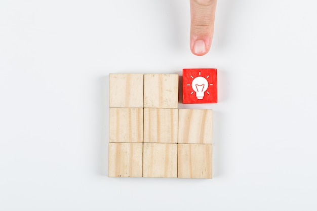 Conceptual of idea hand pointing the idea. with wooden blocks on white background top view. horizontal image Free Photo
