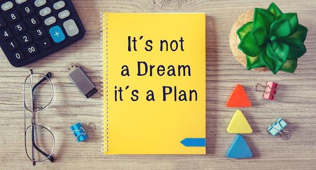 Conceptual manuscript showing it is not a dream it is a plan. Premium Photo
