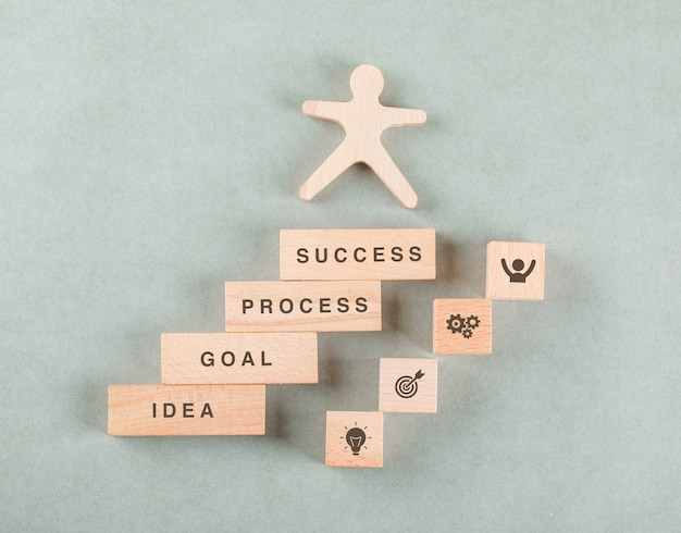 Conceptual of success business with wooden human, rectangle blocks. Free Photo