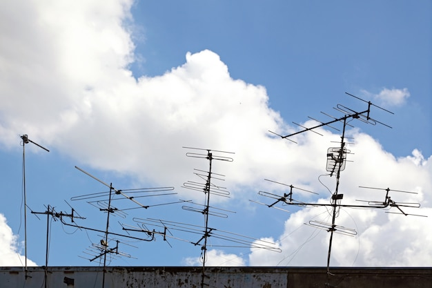 Conceptual of telecommunication antenna on the roof Premium Photo