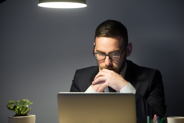 Concerned male thinking about company problem solution Free Photo