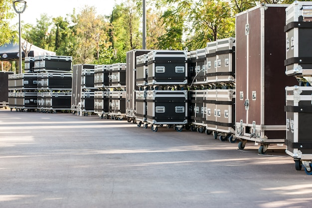 Concert containers. boxes for equipment. preparing the stage for a concert in the open air. Premium Photo