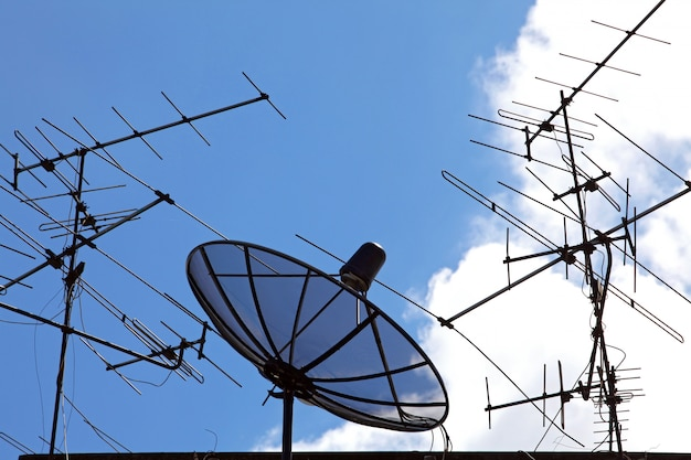 Concpetual of satellite and antenna on blue sky Premium Photo