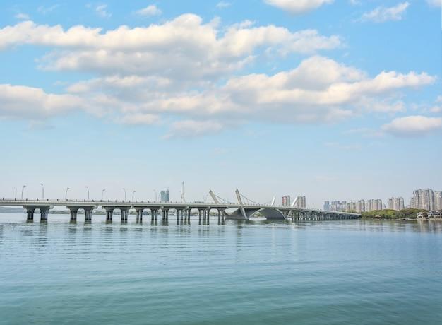 Concrete bridge that crosses the sea Free Photo