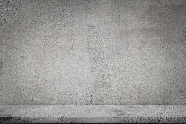Concrete floor with empty grey concrete wall background. Premium Photo