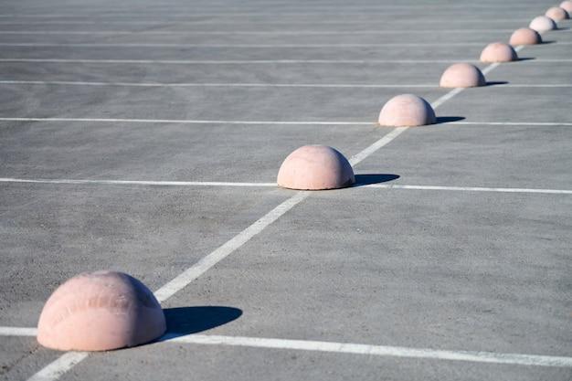 Concrete hemispheres parking limiter Premium Photo