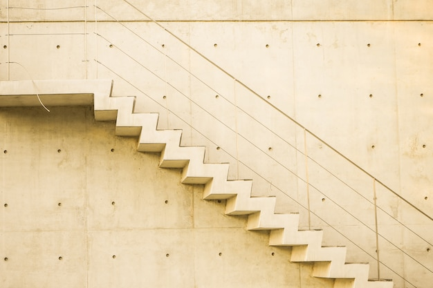 Concrete staircase with concrete wall out of building architecture conceptual idea Premium Photo