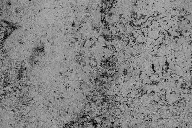 Concrete wall with cracks and scratches Premium Photo