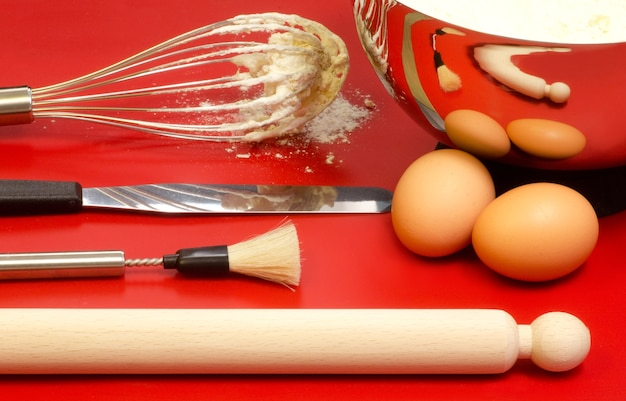 Confectioner utensils with eggs and mixture Premium Photo