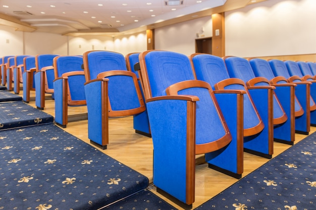 Conference hall with blue seats Premium Photo