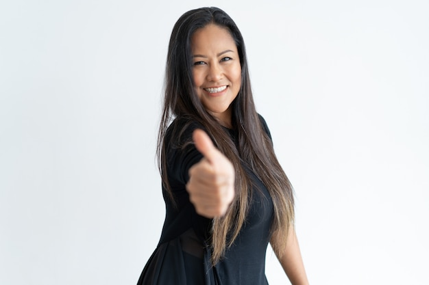 Confident beautiful middle-aged woman showing thumb up Free Photo