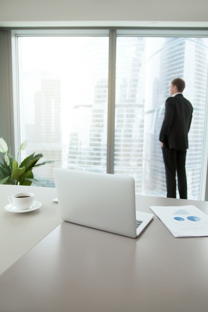 Confident business man contemplating in his office Free Photo
