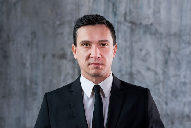 Confident businessman looking at camera Free Photo