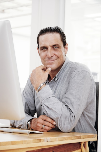 Confident businessman working at office Free Photo