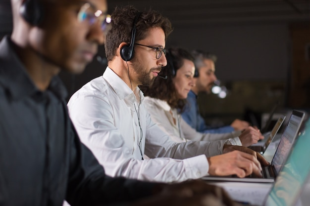 Confident call center operator talking with client Free Photo