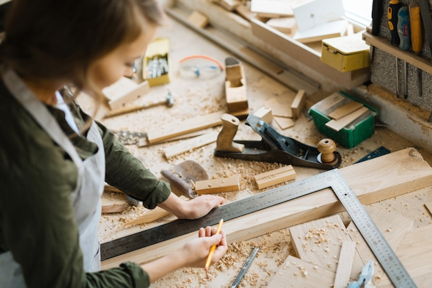 Confident craftswoman wrapped up in work Free Photo