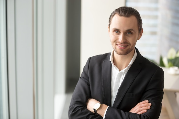 Confident entrepreneur satisfied with own success Free Photo