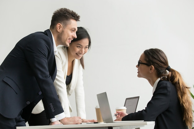 Confident female boss talking to subordinates Free Photo