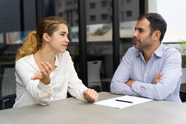 Confident female candidate meeting with company leader Free Photo