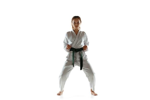 Confident junior in kimono practicing hand-to-hand combat Free Photo