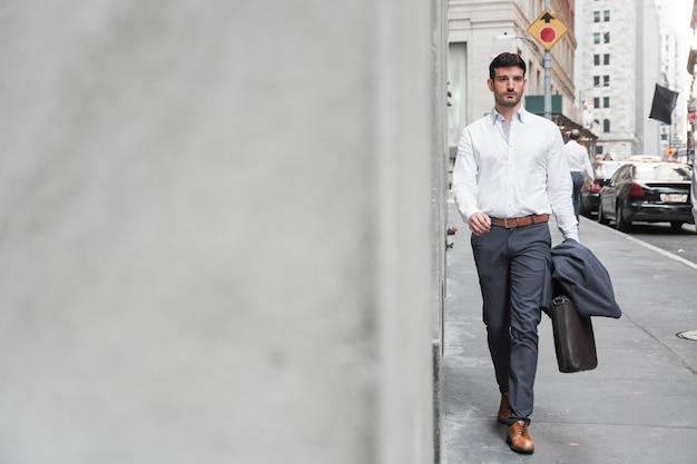 Confident man walking to work Free Photo
