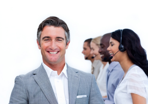 Confident manager and his team working in a call center Premium Photo